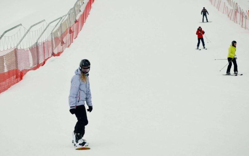 In Silichi Ski resort on a snowboard