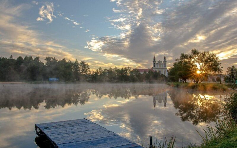 Lake and church in Belarus, trip planner and reasons to visit Belarus
