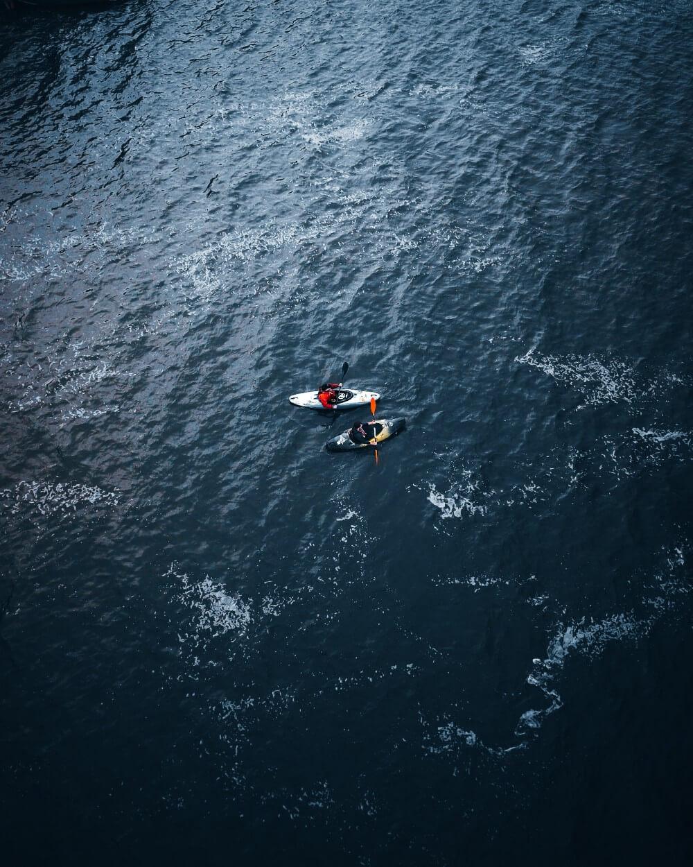 People kayaking in a lake in Belarus, drone view