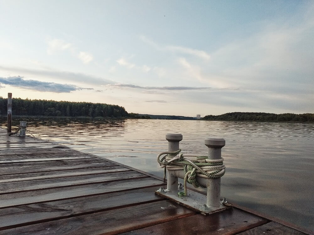 Minsk sea shore with wooden pathway during sunset, Belarus